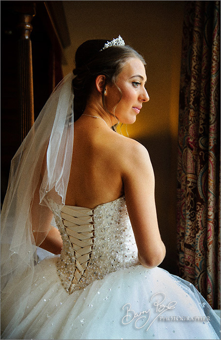 bride in window light closer