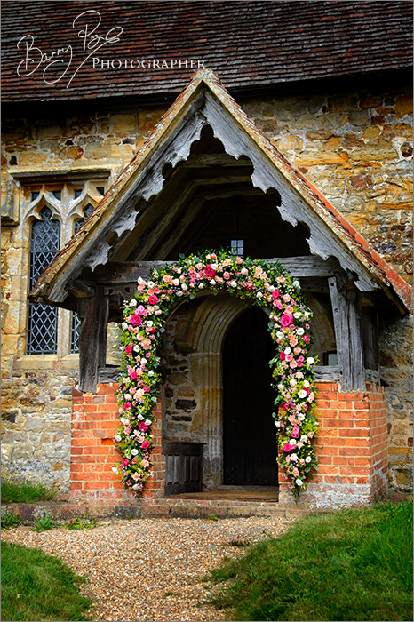 arch of flowers at Penhurst by Barry Page