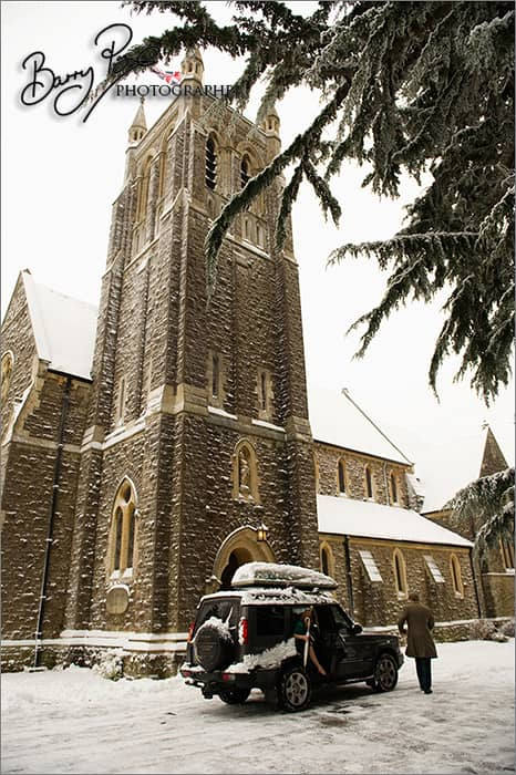 land rover in snow outside church