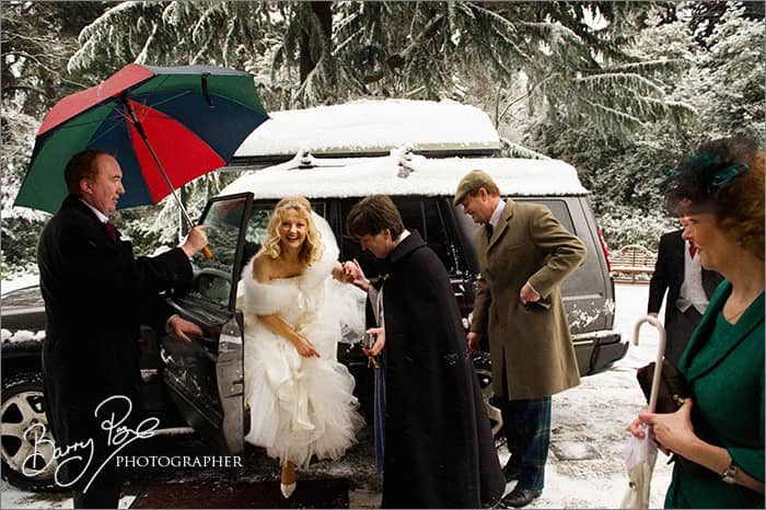 bride arriving at church in snow