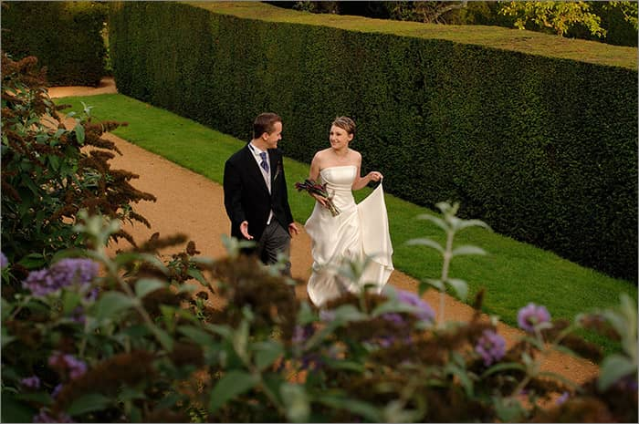 bride and groom garden walk penshurst palce