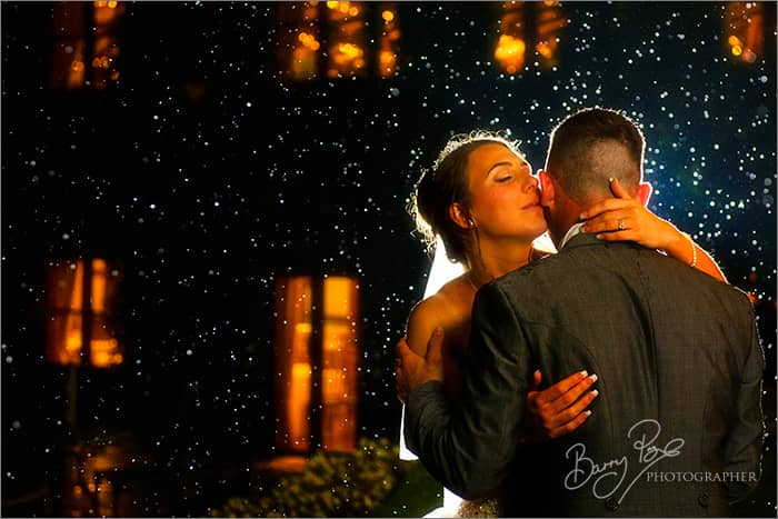 bride and groom romantic night with magic rain
