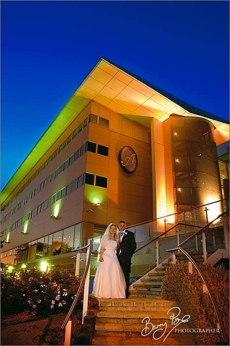 bride and groom aurora hotel nigh shot