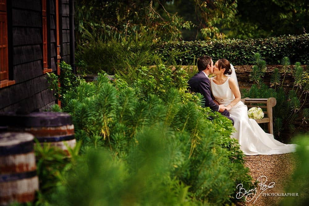 wedding couple kissing in garden bury court barn