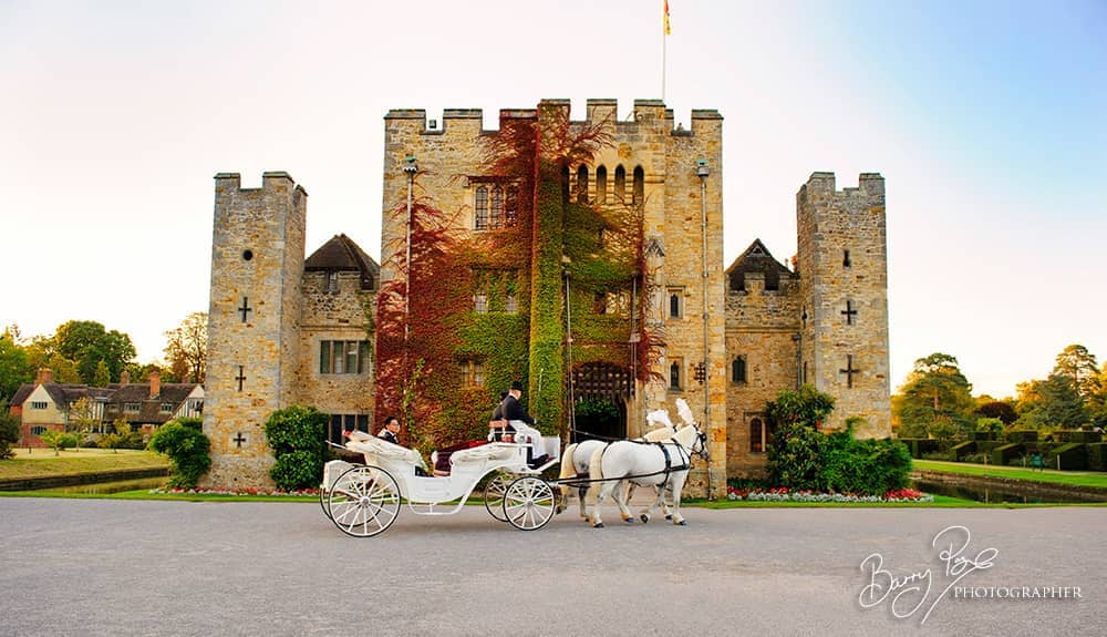 horse and cariage arrives with bride and groom hever castle