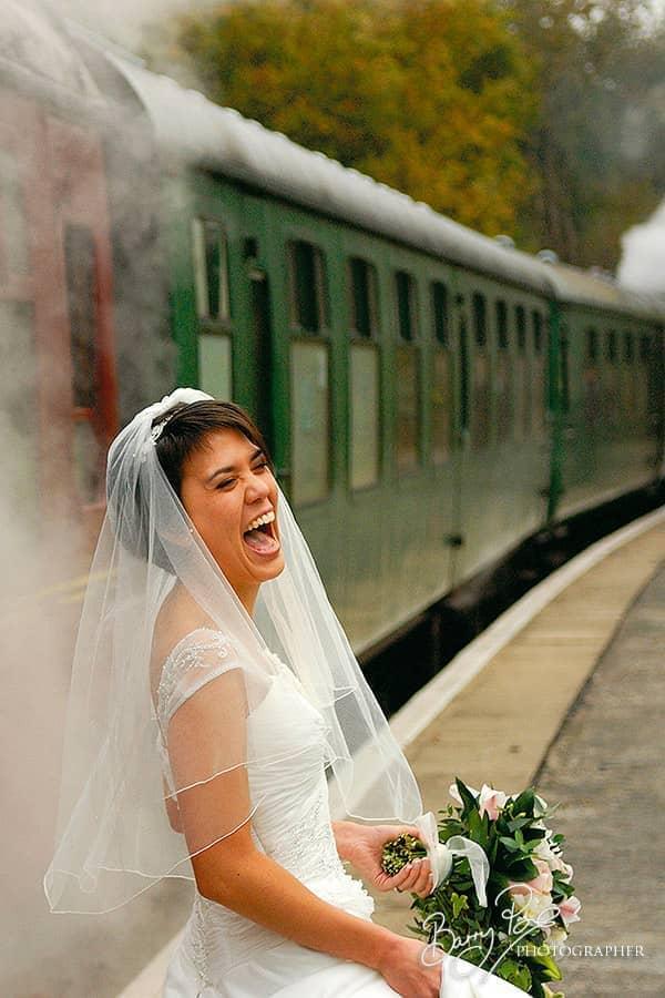 bride big laugh by steam train