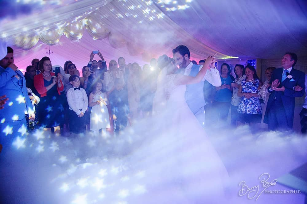 bride and groom first dance in mist