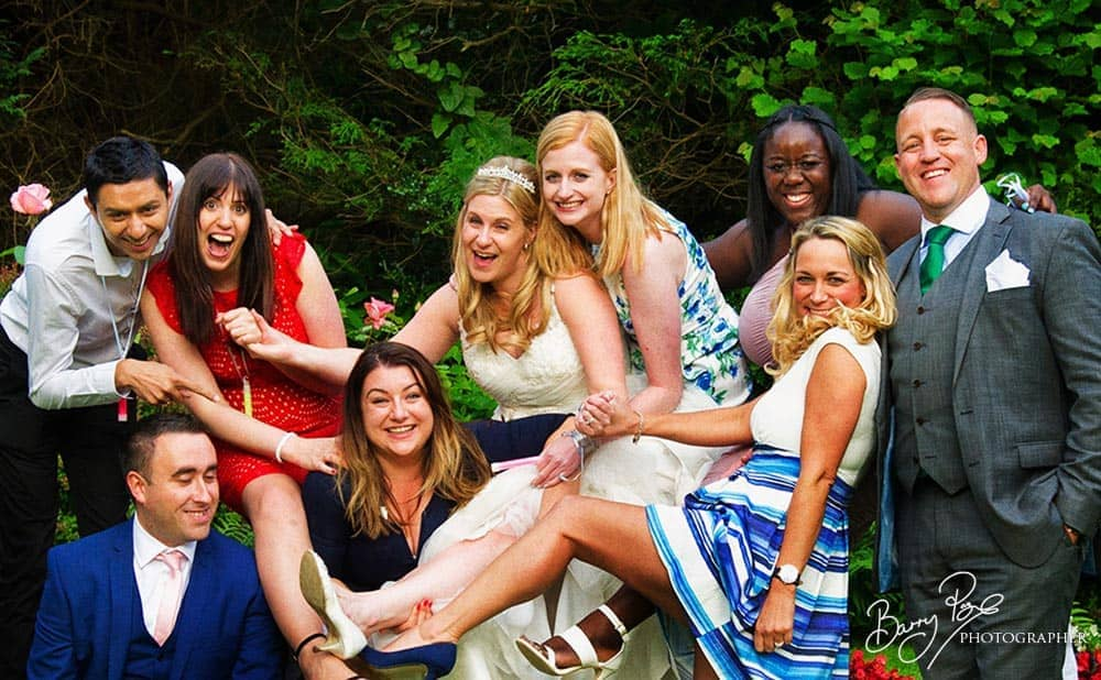 kent wedding photographer barry page takes laughing group shot