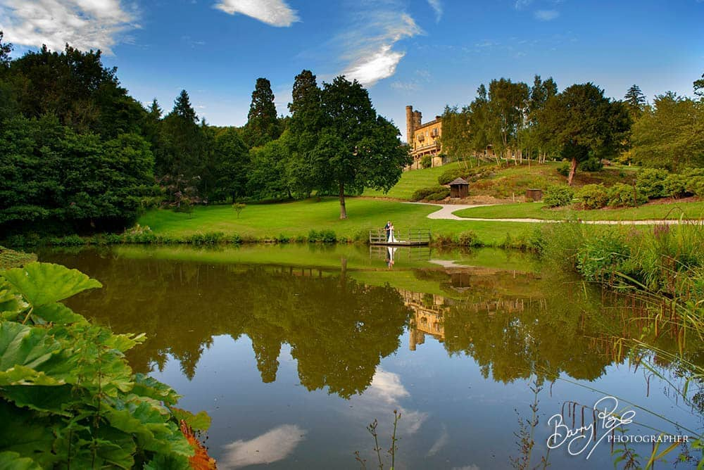 bride and groom by lake at salomons estate