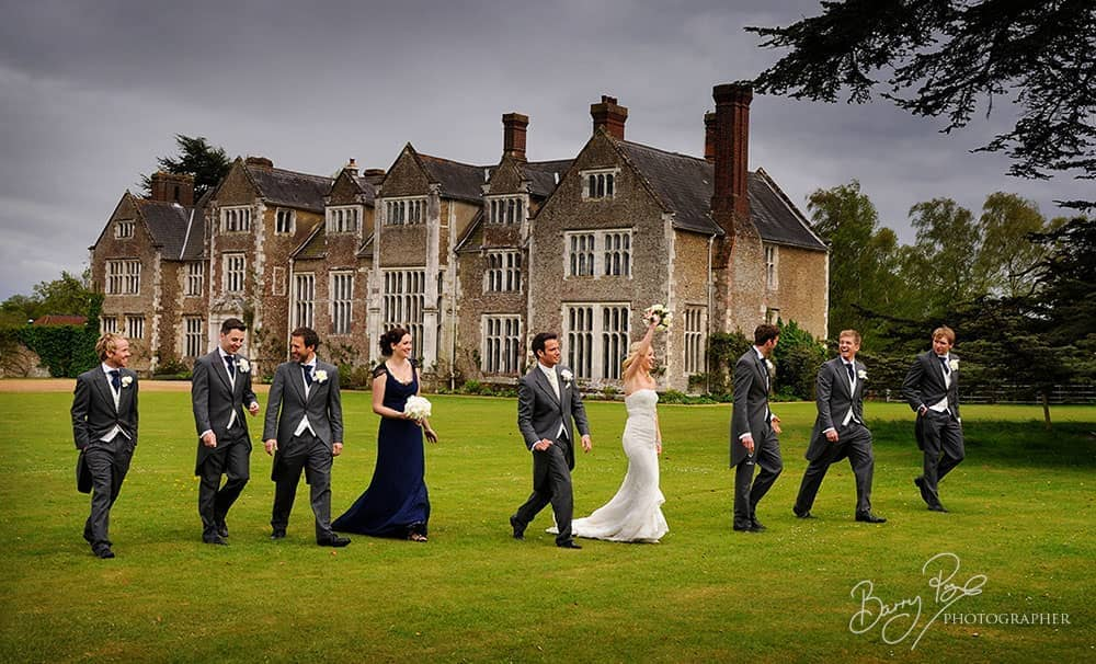 bridal party walking bride waving loseley park surrey