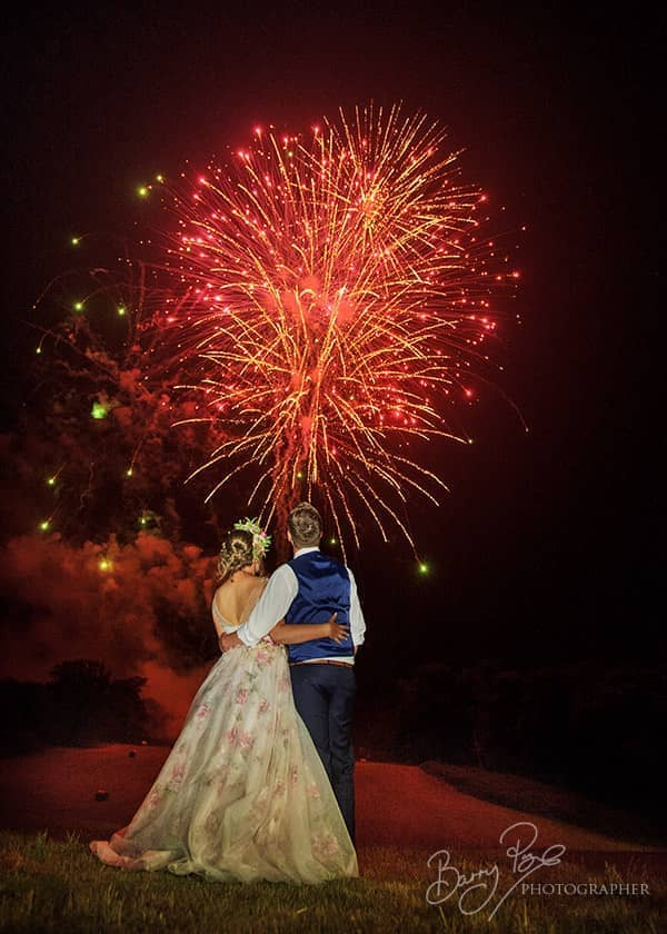 bride and groom watch fireworks