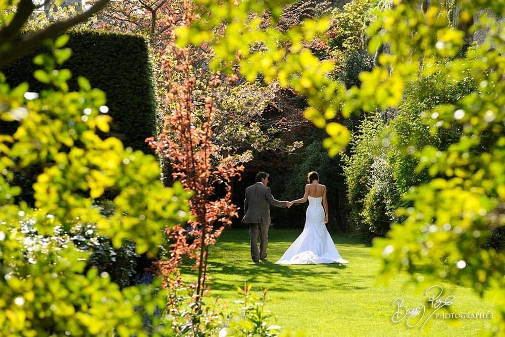 bride and groom in castle garden sunshine