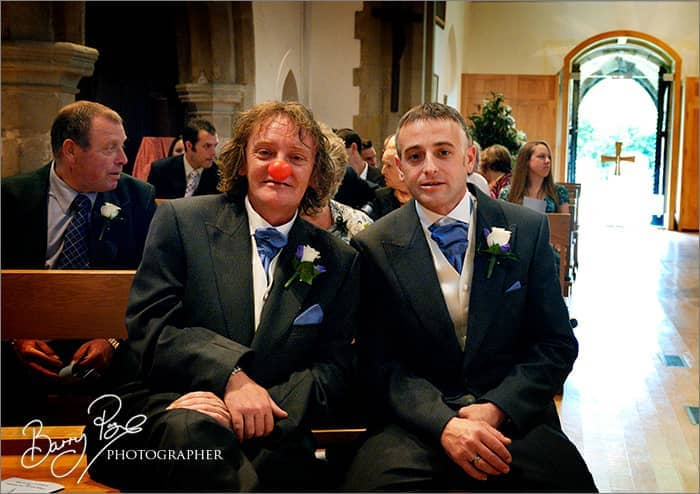 the bestman clown wearing red nose