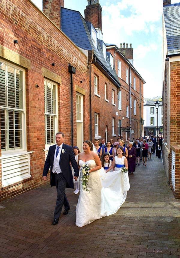 bride and groom and wedding guests walk through tunbridge wells