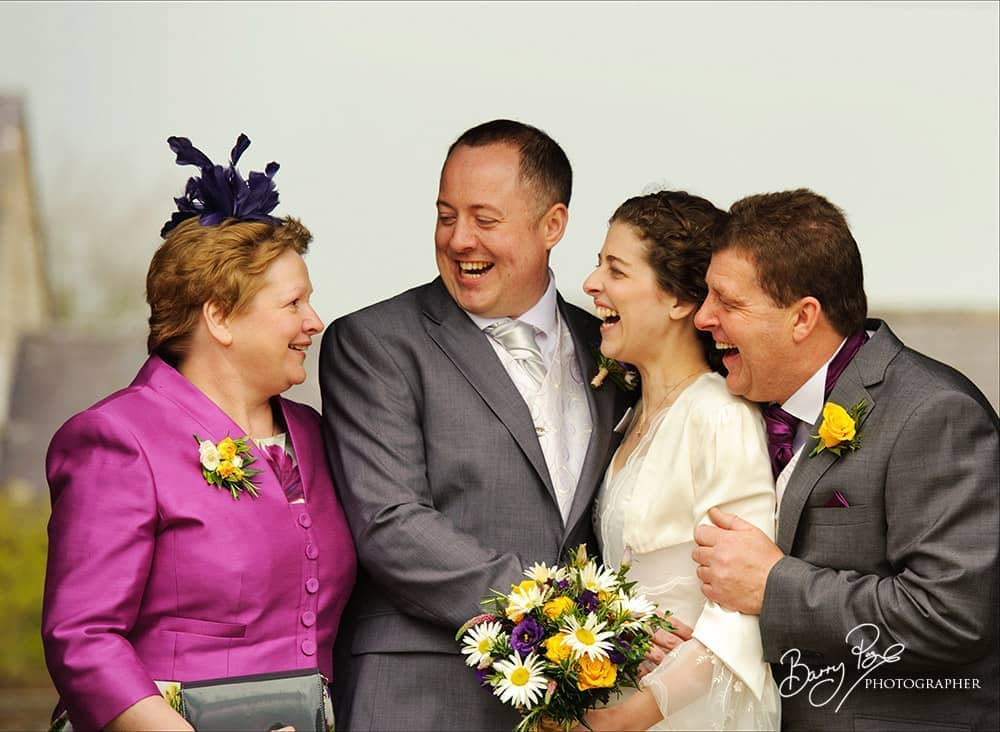 family wedding group laughing