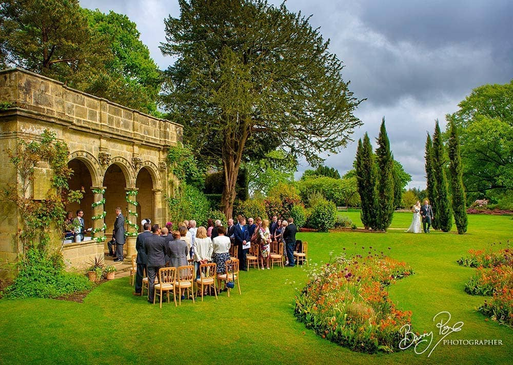 the arrival of the bride nymans outside wedding ceremony
