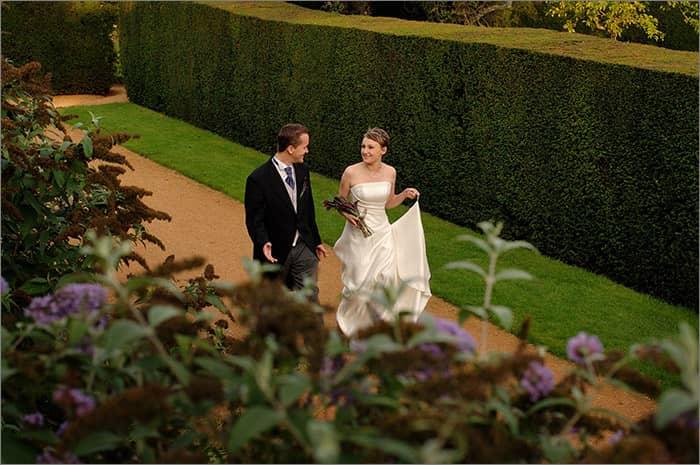 bride and groom garden walk penshurst palce