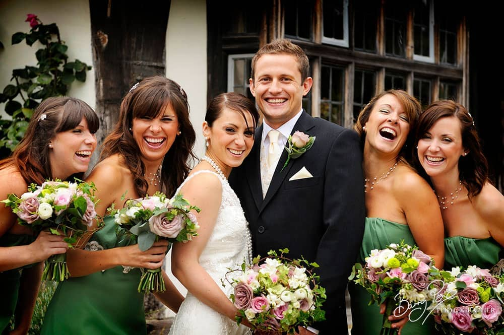 wedding laughing bridal party in rye sussex