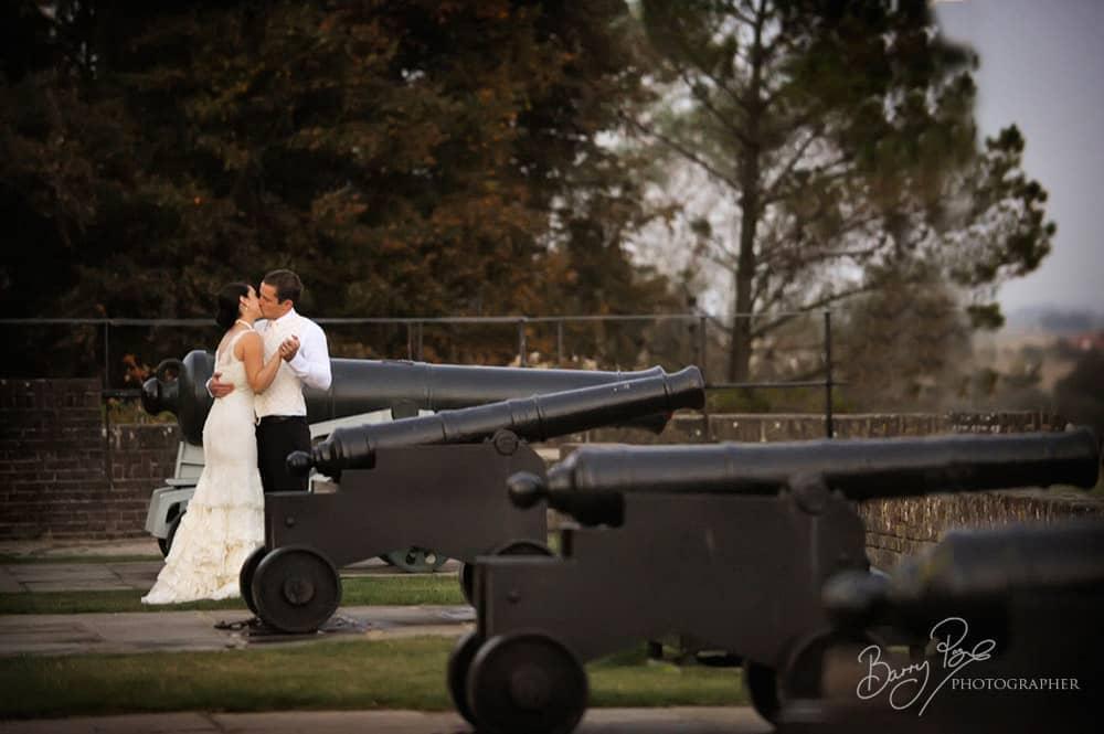 bride and groom kissing gun garden rye sussex