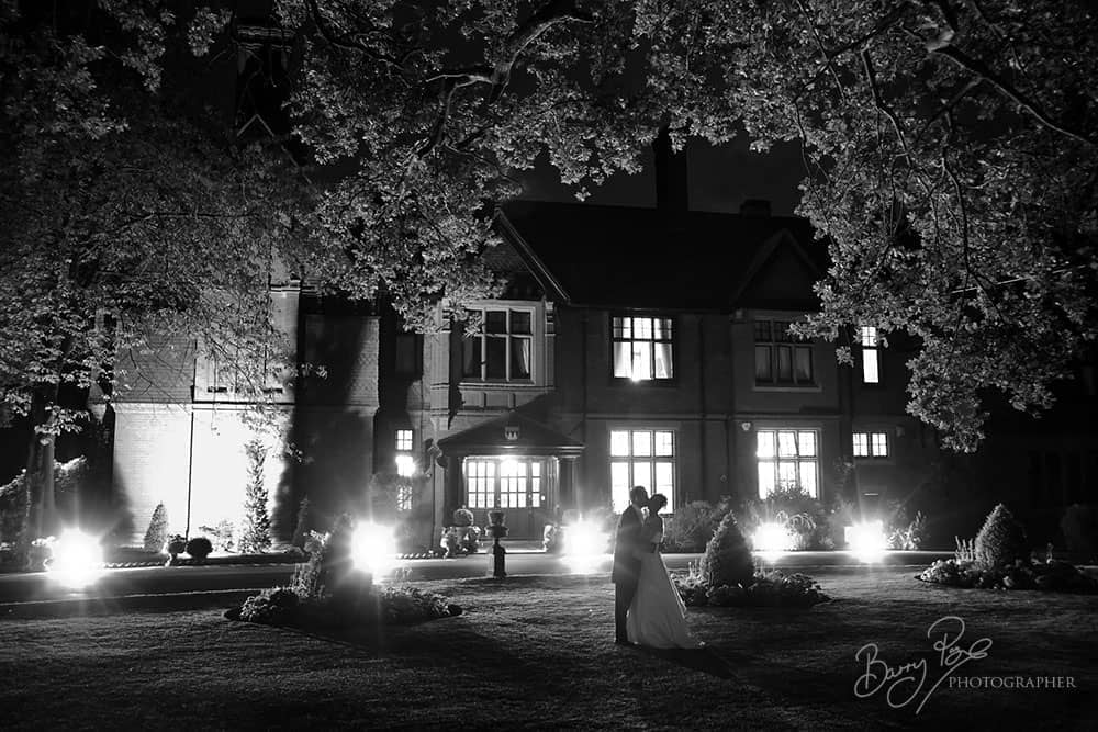 bride and groom at night stanhill court dramatic lighting