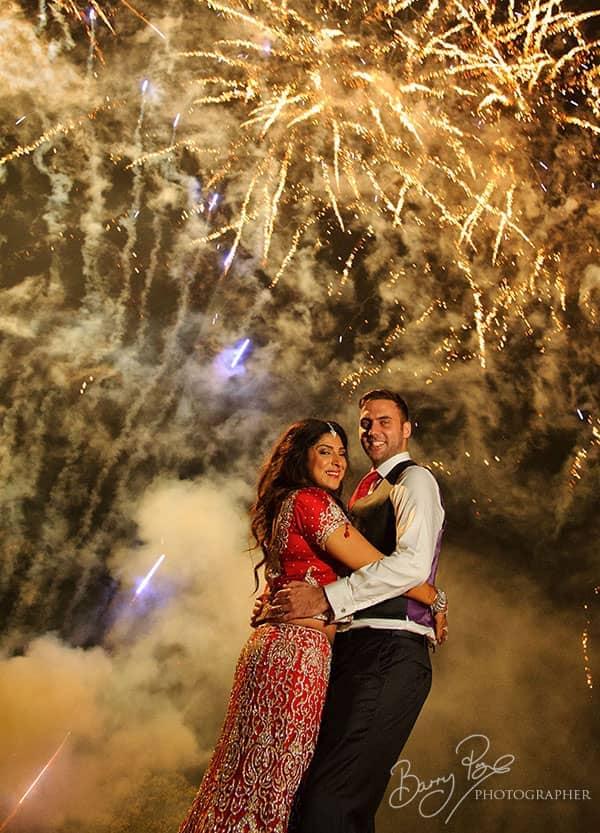 bride and groom fireworks gravetye manor