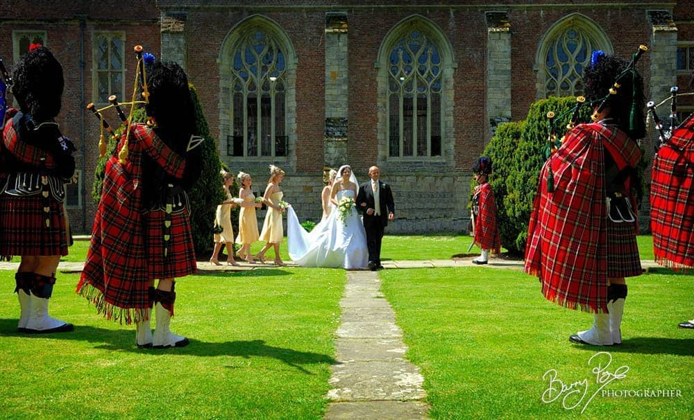 bride arriving pipers playing bagpipes
