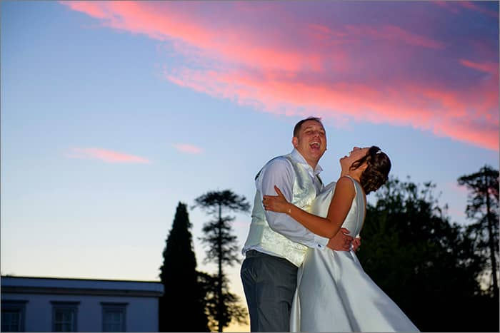 couple in sunset laughing wedding photography buxted park